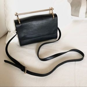 Black clutch with gold hardware & crossbody strap
